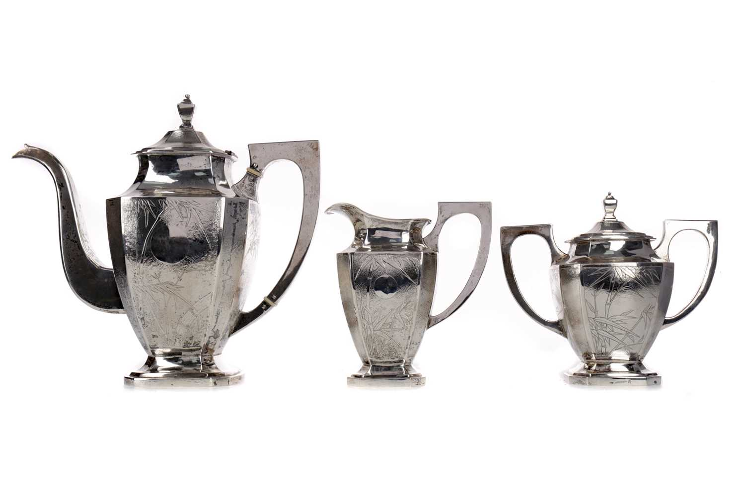 Lot 606 - A CHINESE SILVER TEA SERVICE