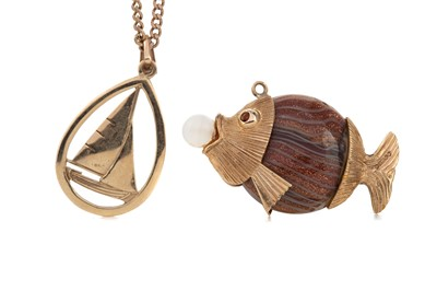 Lot 323 - A GOLD SHIP NECKLACE AND FISH PENDANT