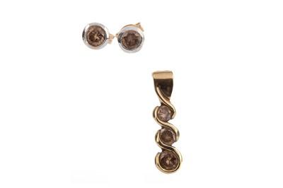 Lot 355 - A PAIR OF COGNAC DIAMOND EARRINGS AND PENDANT