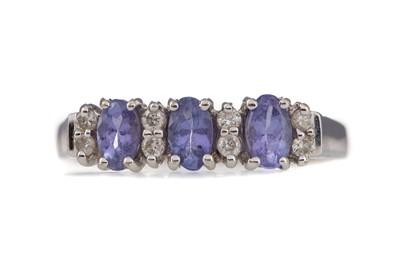 Lot 374 - A TANZANITE AND DIAMOND RING