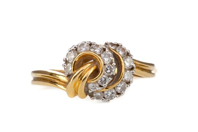 Lot 396 - A DIAMOND DRESS RING