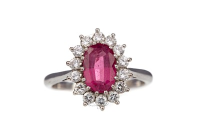 Lot 398 - A RUBY AND DIAMOND CLUSTER RING