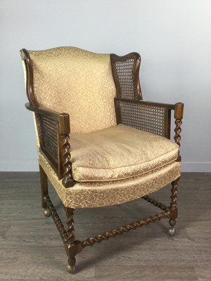 Lot 1748 - AN EARLY 20TH CENTURY CANE PANELLED OAK WINGBACK ARMCHAIR