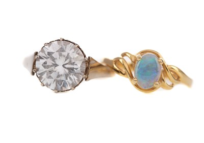Lot 410 - AN OPAL RING AND A LARGE GEM SET RING