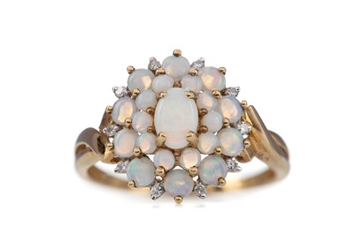 Lot 416 - AN OPAL CLUSTER RING