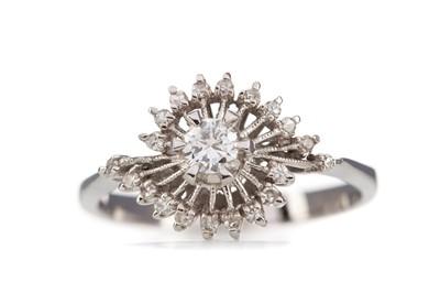 Lot 422 - A DIAMOND DRESS RING