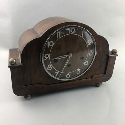 Lot 65 - AN ART DECO WALNUT MANTEL CLOCK