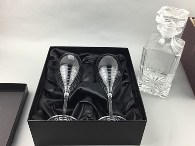 Lot 22 - A CASED PAIR OF WINE GLASSES ALONG WITH A DECANTER