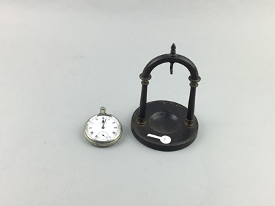 Lot 11 - A POCKET WATCH ON STAND