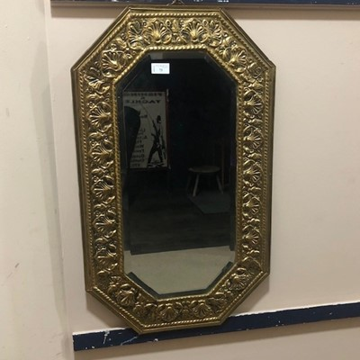 Lot 73 - AN EARLY 20TH CENTURY BRASS FRAMED WALL MIRROR