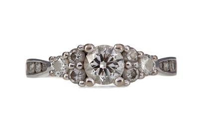Lot 415 - A DIAMOND DRESS RING
