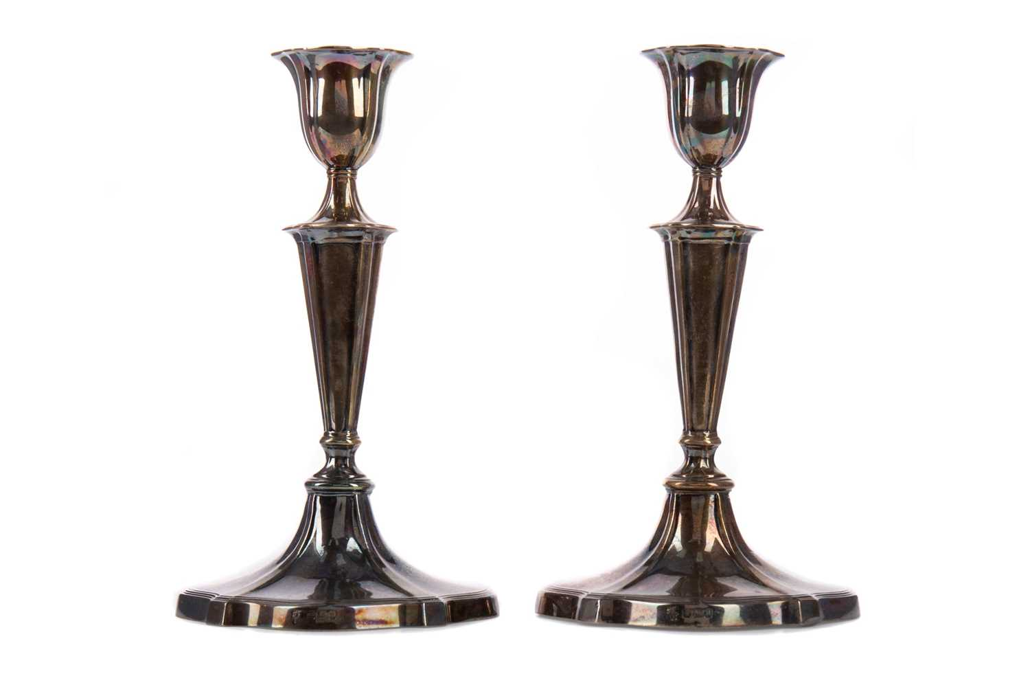Lot 404 - A PAIR OF EDWARDIAN SILVER CANDLE STICKS