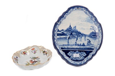 Lot 1011 - A DUTCH BLUE & WHITE OVAL SHAPED WALL PLAQUE AND A MEISSEN STYLE DISH