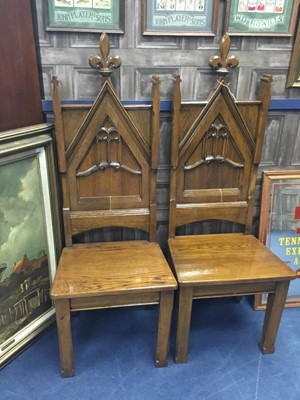 Lot 80A - A PAIR OF EARLY 20TH CENTURY OAK HALL CHAIRS