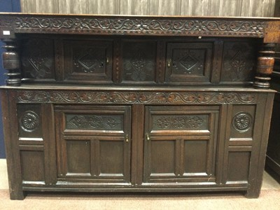 Lot 1365 - A 17TH CENTURY AND LATER CARVED OAK COURT CUPBOARD