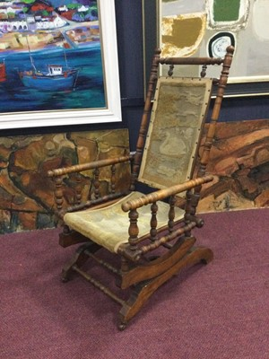 Lot 74 - A VICTORIAN ROCKING CHAIR