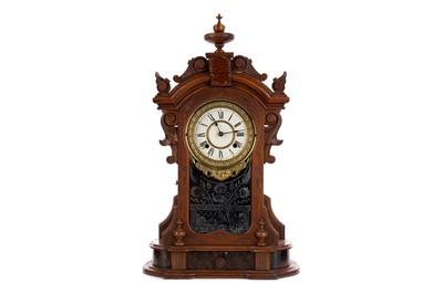 Lot 1159 - A VICTORIAN WALNUT MANTEL CLOCK