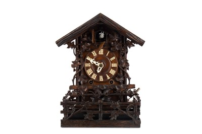 Lot 1160 - A LATE 19TH CENTURY BLACK FOREST CUCKOO CLOCK
