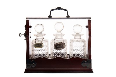 Lot 1375 - A MAHOGANY AND SILVER PLATED THREE BOTTLE TANTALUS