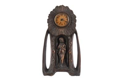 Lot 1167 - AN ART NOUVEAU FIGURAL MANTEL CLOCK