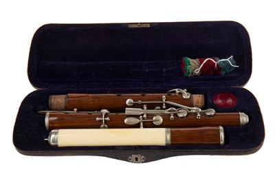 Lot 1169 - A LATE 19TH/EARLY 20TH CENTURY IVORY MOUNTED ROSEWOOD FLUTE