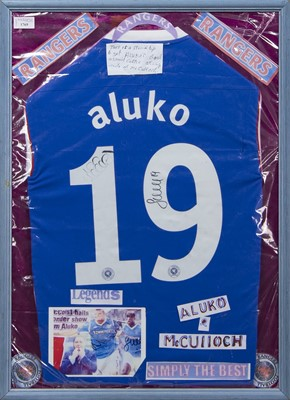 Lot 1769 - A LEE McCULLOCH AND SONE ALUKO SIGNED RANGERS F.C. JERSEY