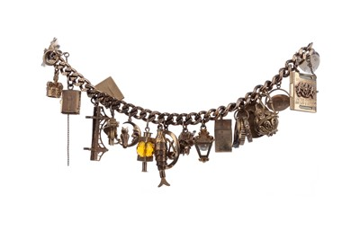Lot 831 - A GOLD CHARM BRACELET ALONG WITH A FORTH BRIDGE CHARM ON CHAIN
