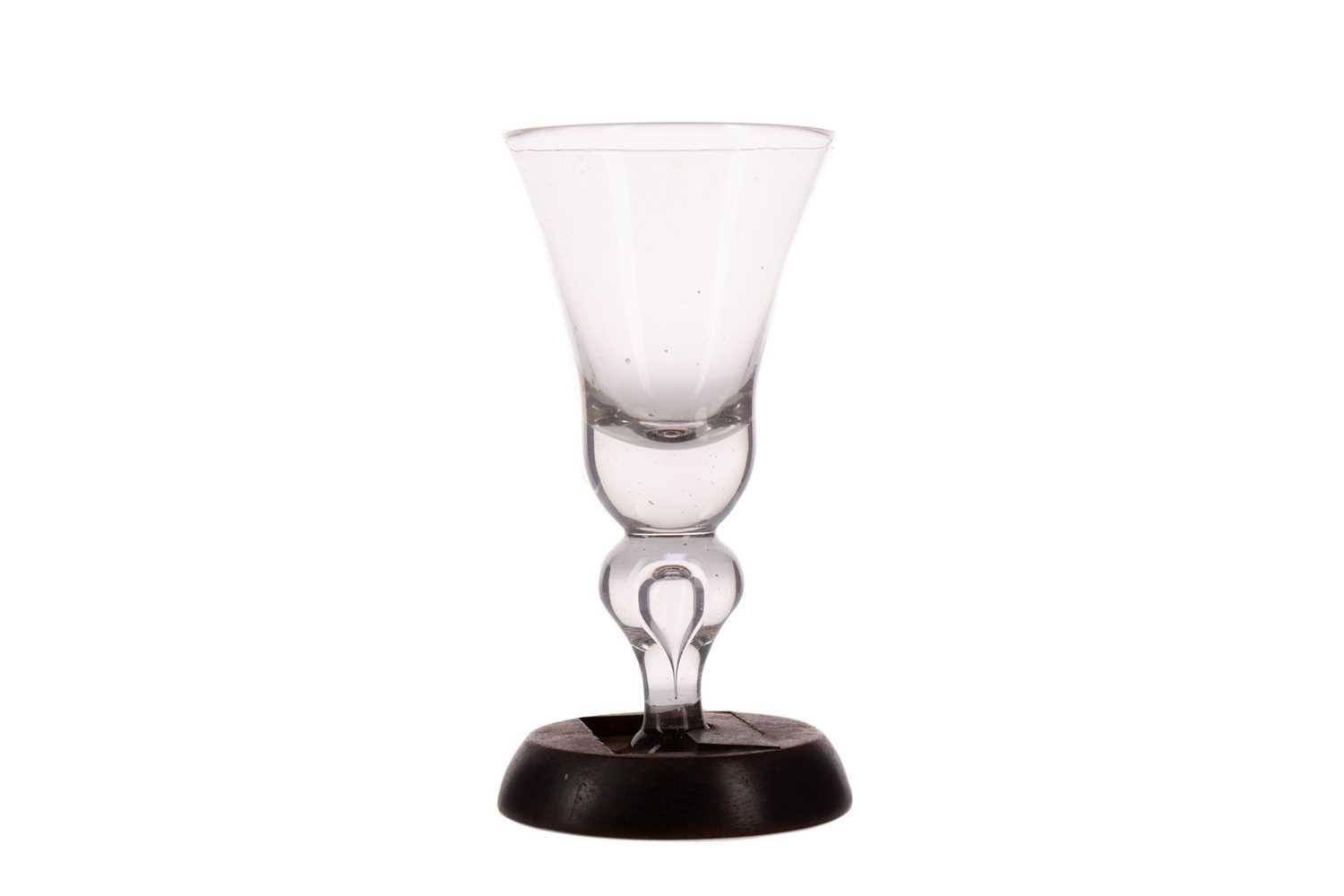 Lot 1014 - AN EARLY 18TH CENTURY NEWCASTLE HEAVY BALUSTER WINE GLASS