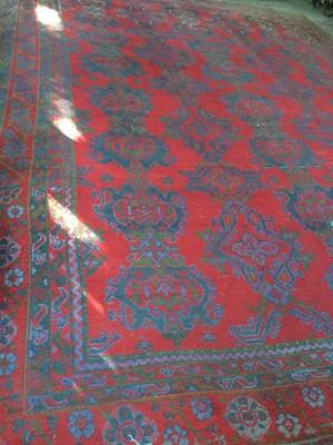 Lot 1447 - A TURKEY BORDERED CARPET