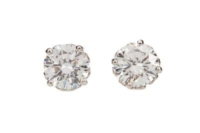 Lot 885 - A PAIR OF DIAMOND STUD EARRINGS