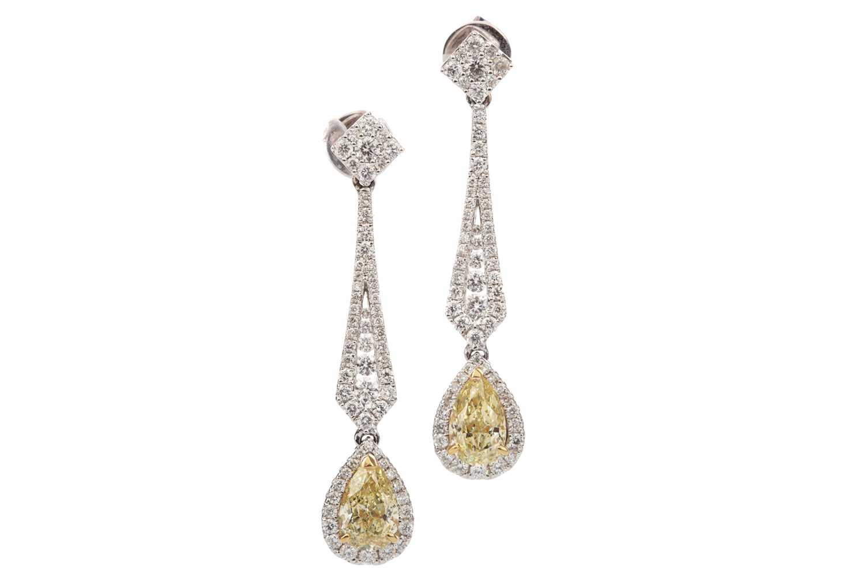Lot 895 - A PAIR OF GIA CERTIFICATED FANCY YELLOW DIAMOND EARRINGS
