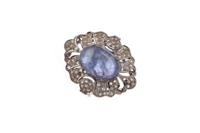 Lot 896 - A TANZANITE AND DIAMOND RING