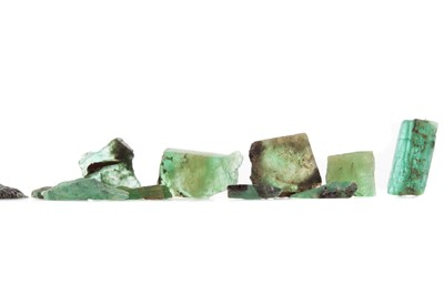 Lot 1526 - **A GROUP OF UNMOUNTED ROUGH EMERALDS