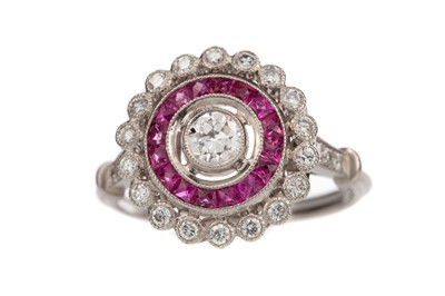 Lot 879 - A RUBY AND DIAMOND TARGET RING