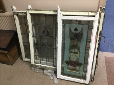Lot 87 - A SET OF THREE STAINED AND LEADED GLASS PANELS