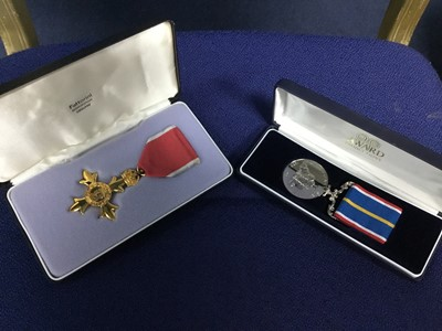 Lot 48 - AN OBE MEDAL IN ORIGINAL CASE AND ANOTHER MEDAL