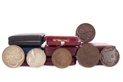 Lot 1772 - A COLLECTION OF SIXTEEN EARLY 20TH CENTURY UNIVERSITY ATHLETICS MEDALS