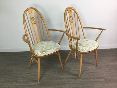 Lot 90 - A SET OF FOUR ERCOL SWAN BACK DINING CHAIRS