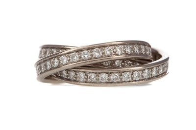 Lot 949 - A CARTIER DIAMOND TRINITY RING