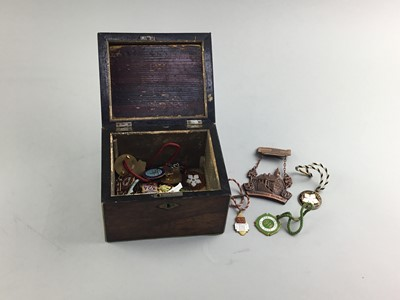Lot 69 - A LATE 19TH CENTURY ROSEWOOD TEA CADDY AND ENAMEL BADGES