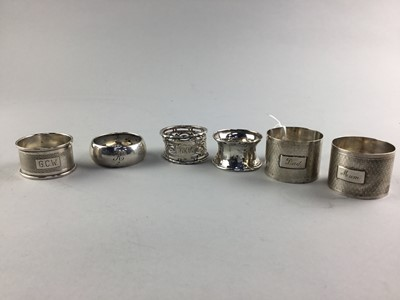 Lot 74 - A PAIR OF EARLY 20TH CENTURY SILVER ENGINE TURNED NAPKIN RINGS AND FOUR OTHER NAPKIN RINGS