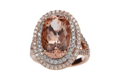 Lot 897 - A MORGANITE AND DIAMOND RING