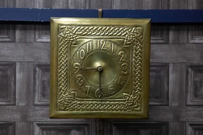 Lot 1189 - AN ARTS & CRAFTS BRASS WALL CLOCK