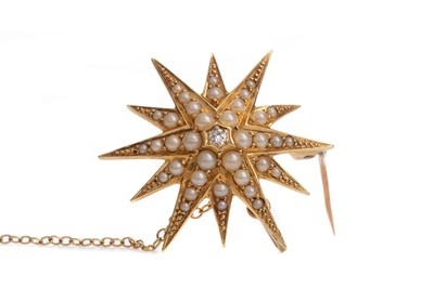 Lot 308 - A DIAMOND AND SEED PEARL STAR BROOCH