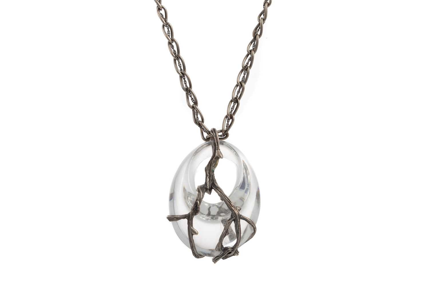 Lot 1042 - A LALIQUE CRYSTAL AND SILVER 'RONCES' PATTERN PENDANT