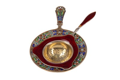 Lot 466 - TWO SILVER AND ENAMEL TEA STRAINERS