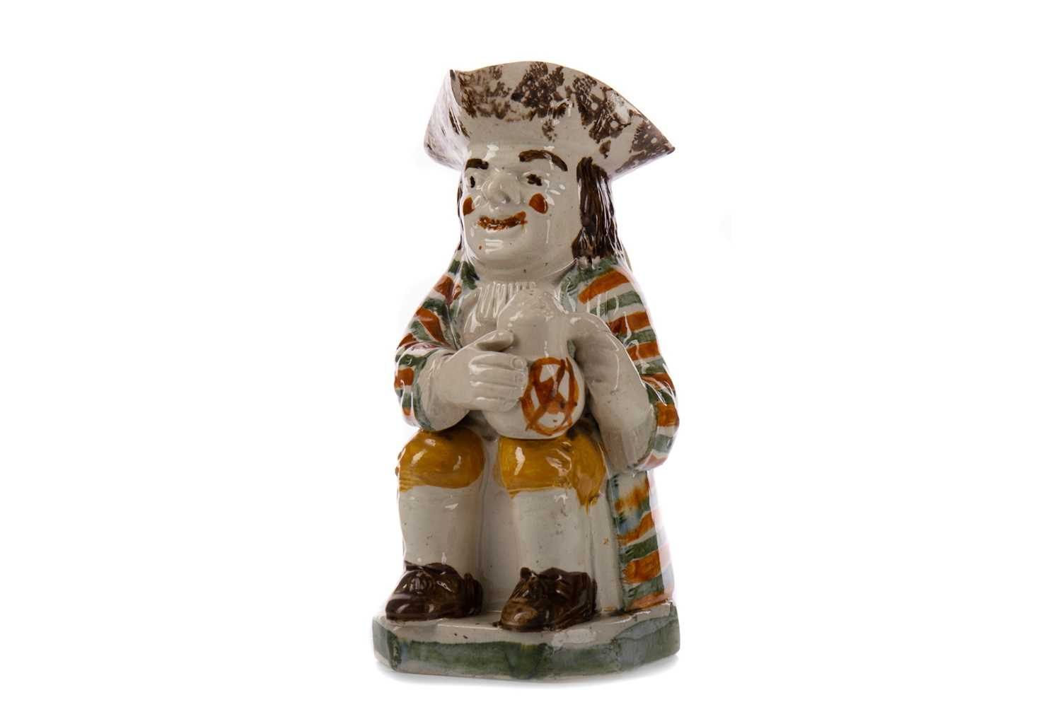 Lot 1047 - AN EARLY 19TH CENTURY TOBY JUG