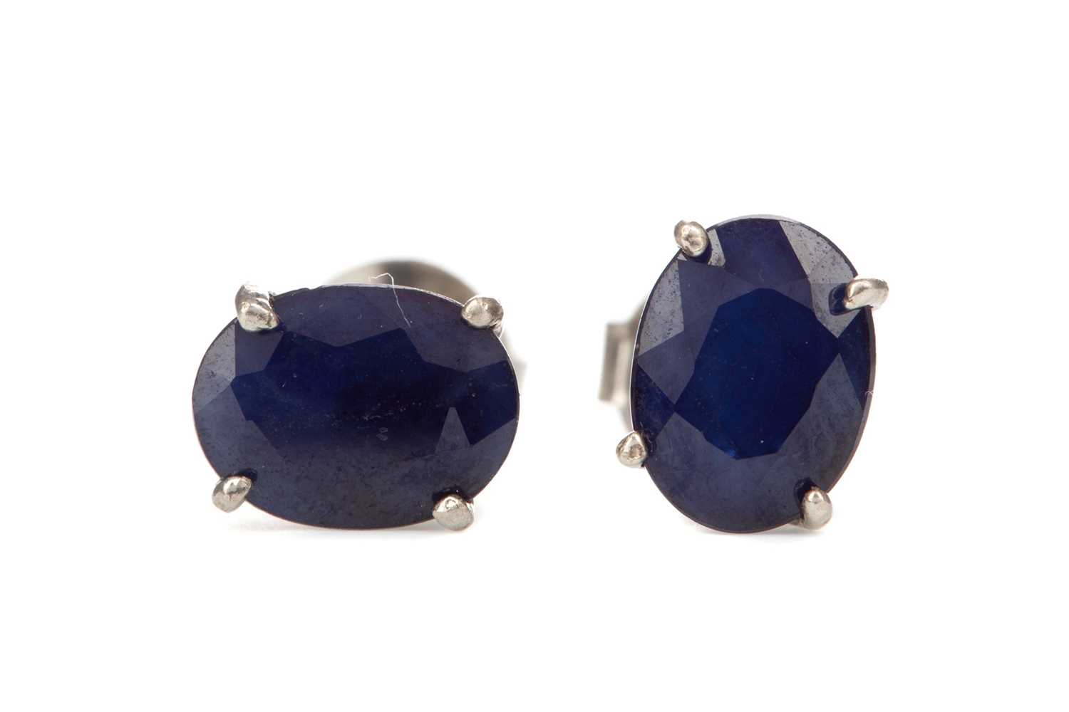 Lot 360 - A PAIR OF TREATED SAPPHIRE EARRINGS