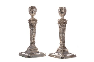 Lot 473 - A PAIR OF LATE VICTORIAN SILVER PLATED CANDLESTICKS