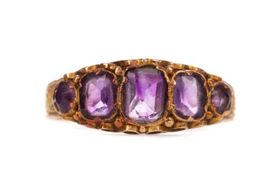 Lot 401 - A VICTORIAN AMETHYST FIVE STONE RING